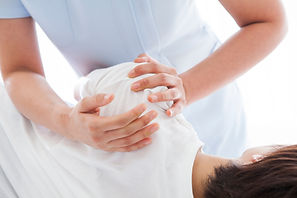 Osteopath holding patient's shoulder