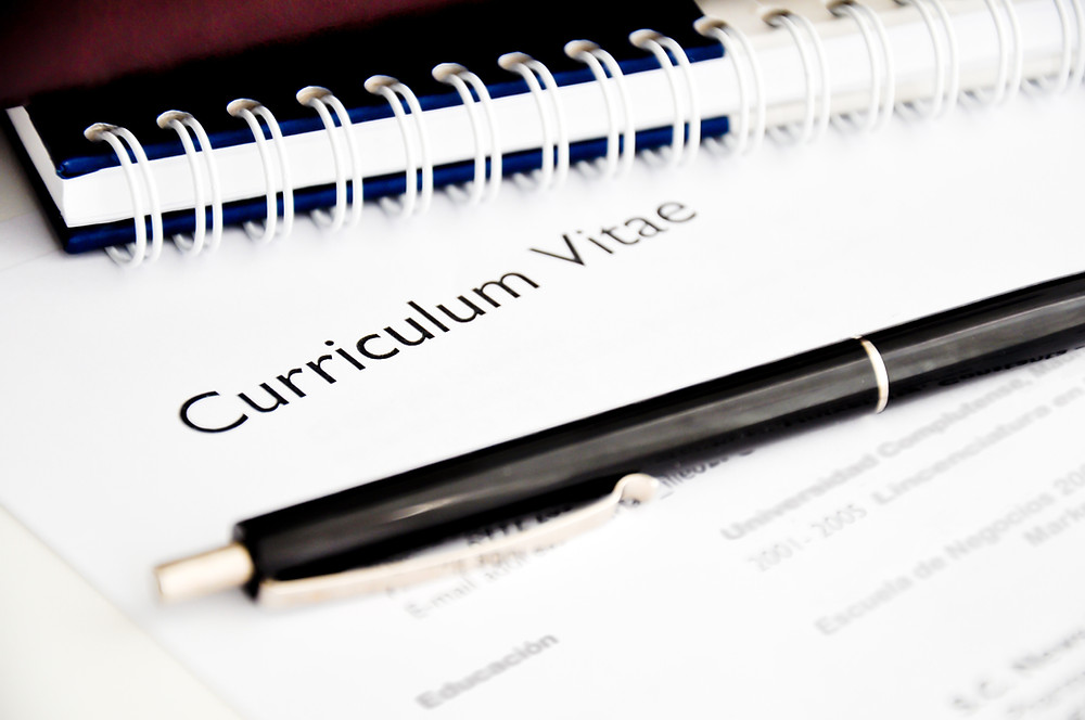Picture of a Curriculum Vitae with a pen on top of it