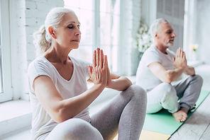 Senior Couple Doing Kind Karma Yoga.