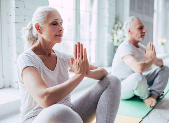 senior-couple-doing-yoga
