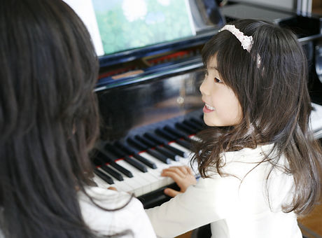 Child Playing the Piano