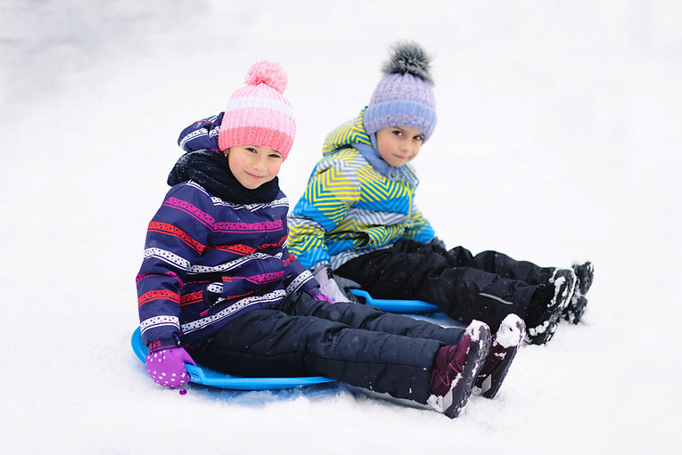 Kids Sledding in Snow