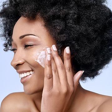 Applying Facial Cream for smooth skin