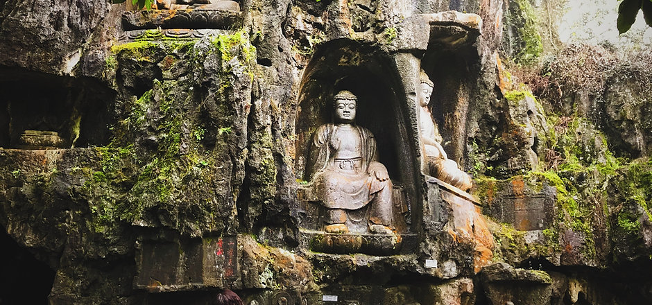 Buddha Statues Carved into Mountainside