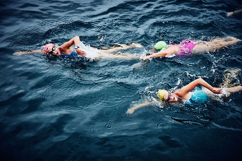 An Aerial View of Swimmers in the Sea