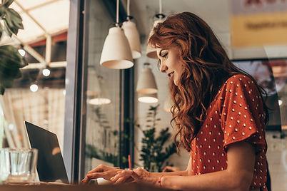 Woman joining the urbanswan membership using her laptop