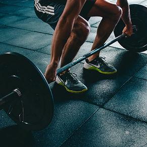 Man lifting barbell weights