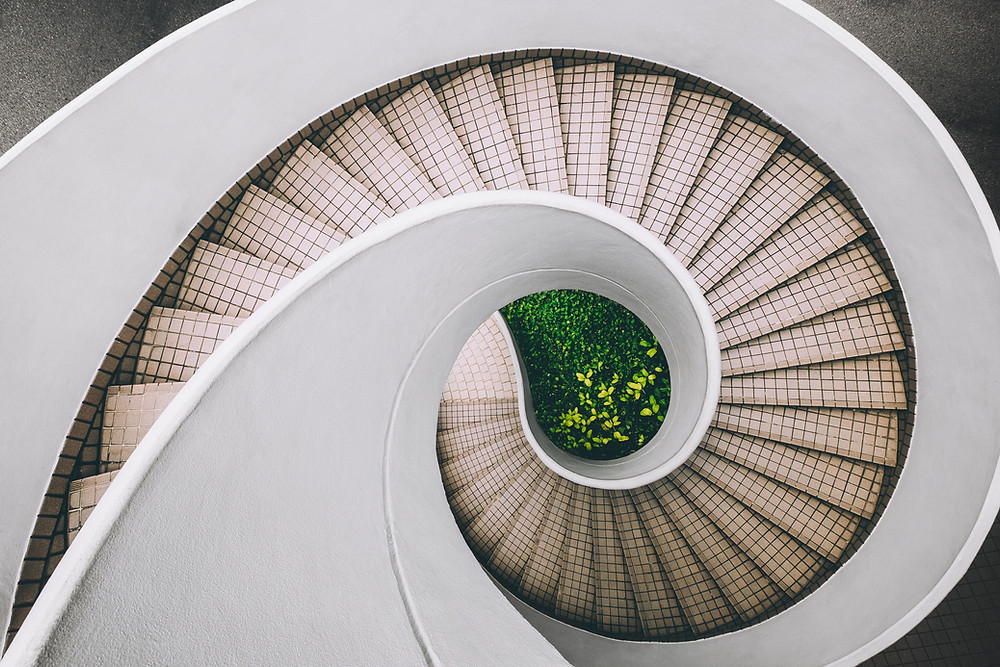 A circular staircase, viewed from above.