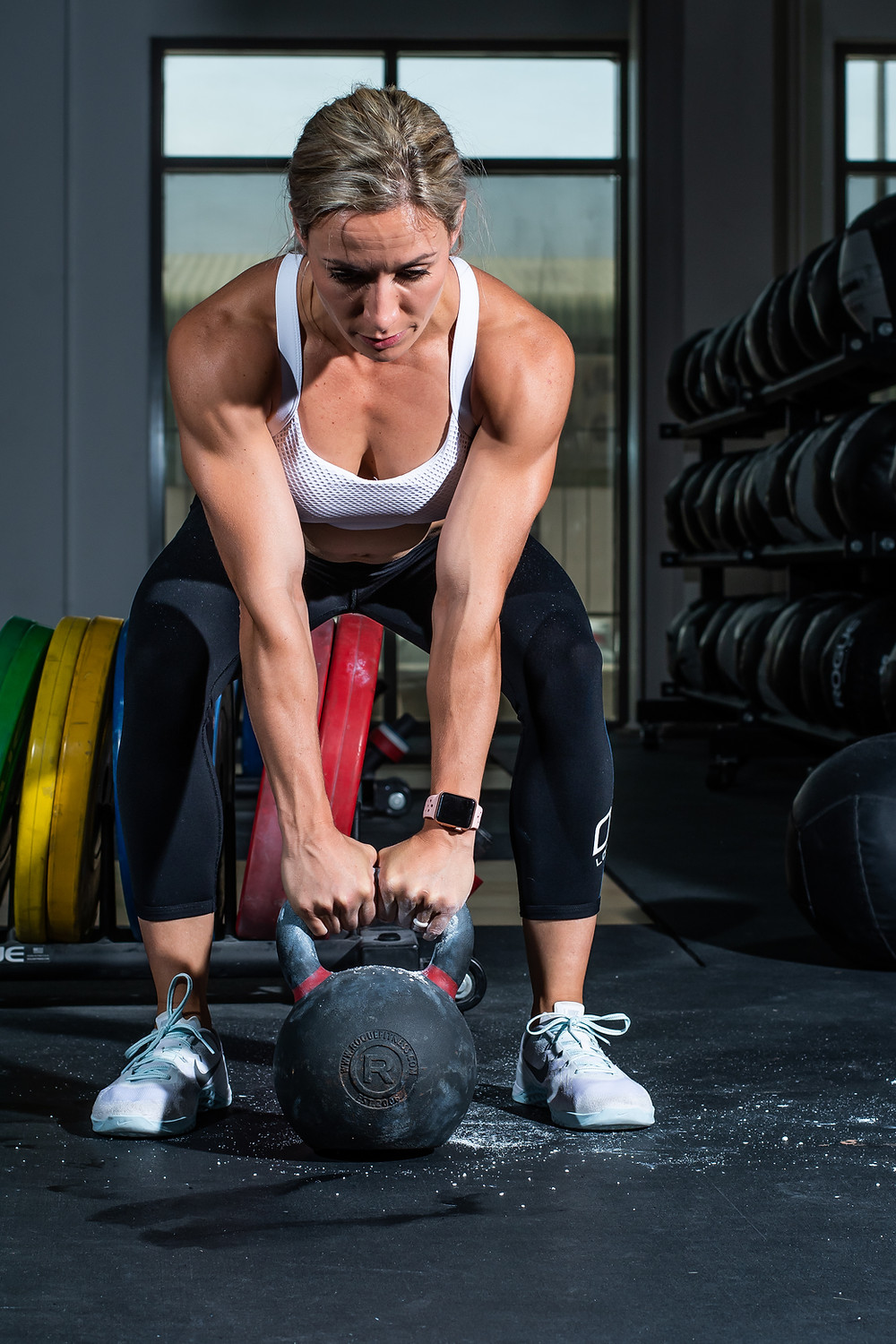 a woman about to perform a kettlebell swing.