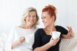 Women Laughing on Couch