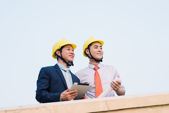Managers Supervising Construction Site
