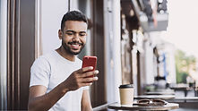 Smiling Man with a Smartphone