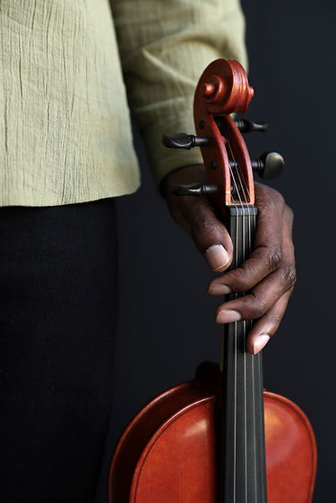 Brazilian man holding a violin