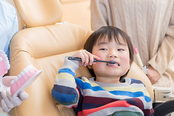 Child Brushing Teeth at the dentist office