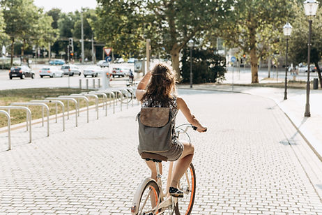 a girl is riding a bike in the city
