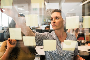 Two women creating an ideas board | The Open Mind Institute