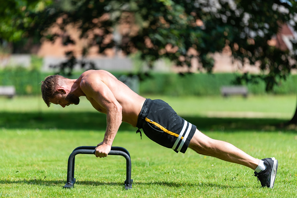 a man performing press-ups as a[art of a circuit training session.