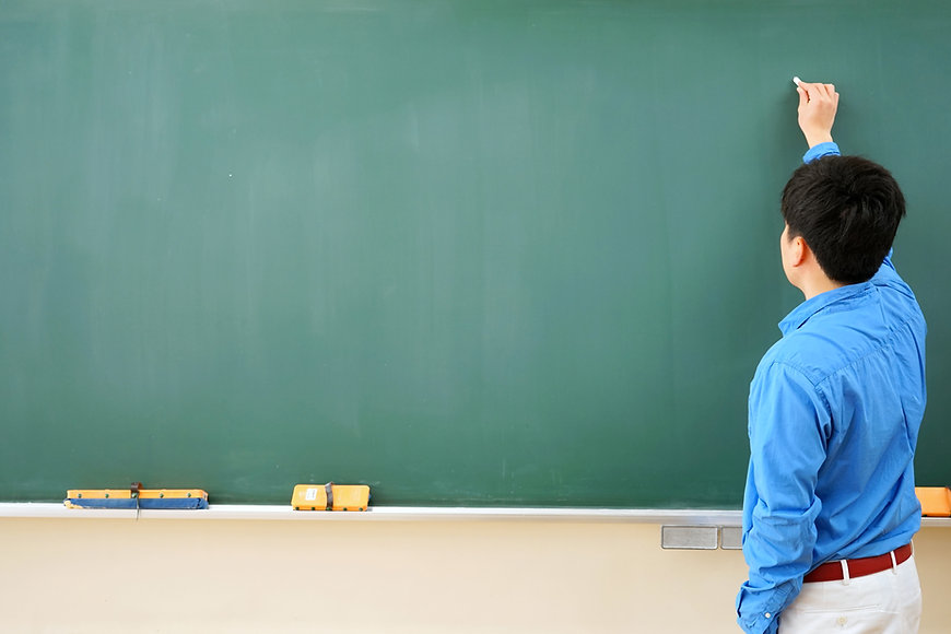Teacher and Blackboard
