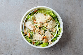 Top shot of a farmers market salad in paper bowl