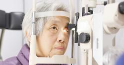 Woman Having Eyes Examined