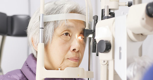 Woman Having Eyes Examined