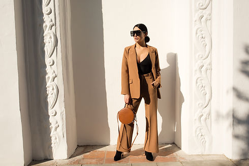 Woman in Camel Suit