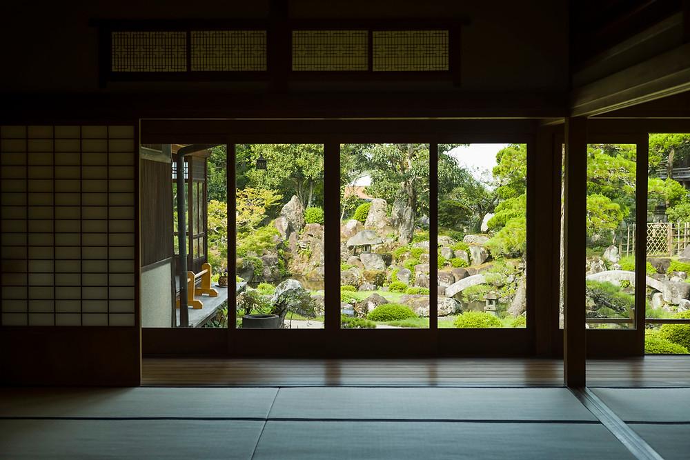 Japanese landscape through windows of empty room