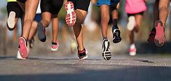 men running in trainers