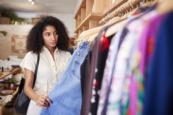 Woman Browsing in Clothing Store