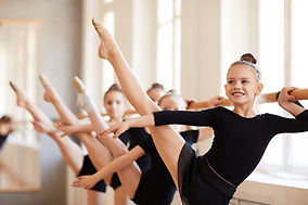Young Gymnasts Practicing Pointe