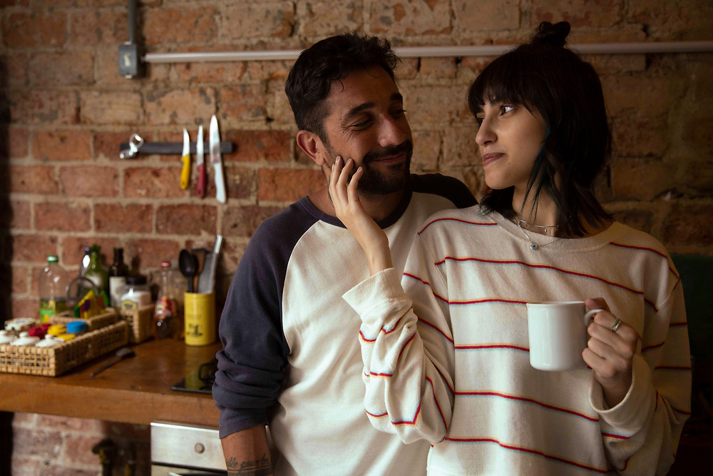 couple standing in kitchen with tea