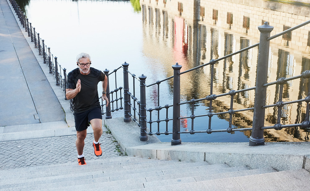 a man running up stairs keeping fit and healthy
