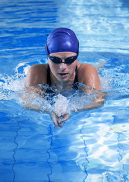 Woman Swimming in Pool