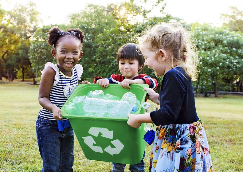 Girls Carrying a Recycling Bin