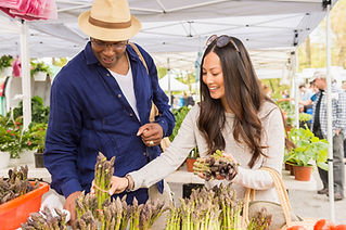 Couple Buying Asparagus