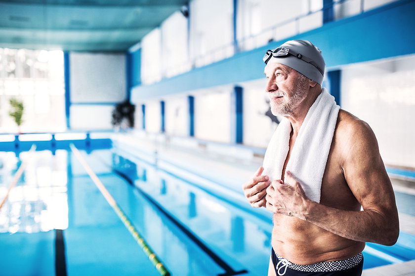 A senior man by the swimming pool