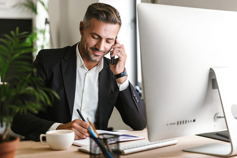 Smiling executive search consultant having a phone call with the client