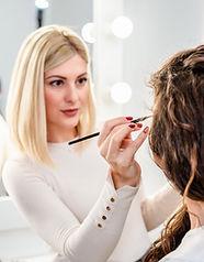 Makeup Artist giving a Makeup Lesson.