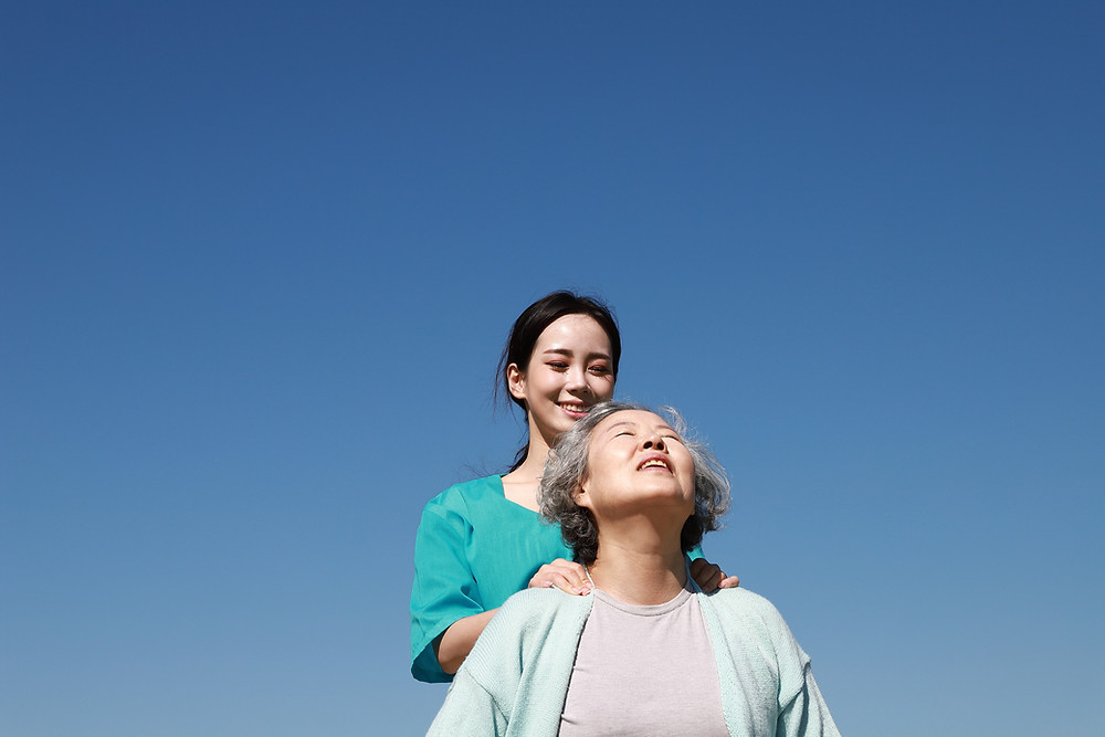 An old lady enjoying the naked sky with a doctor.