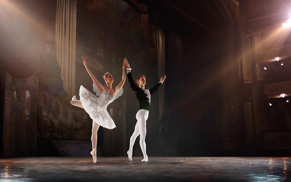 Ballet dancer & ballerina on stage getting ovation