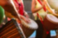 People Playing Djembe