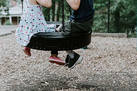 Friends on a Swing
