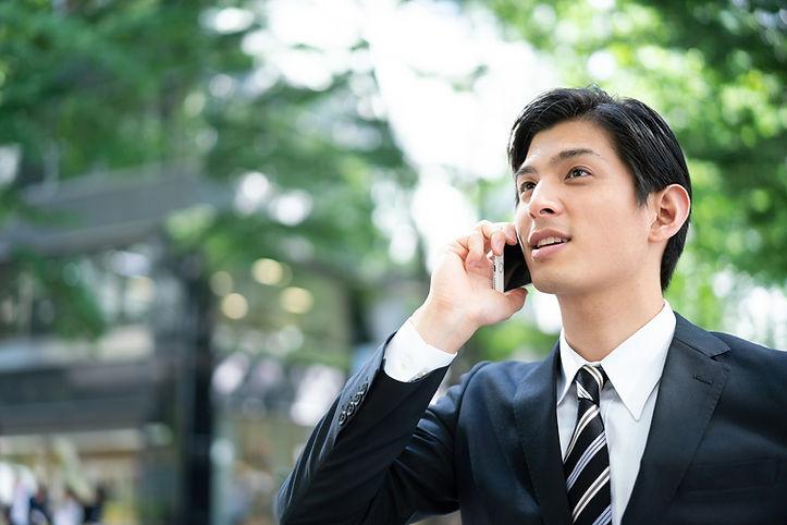 ビジネスマン、スマホ 電話