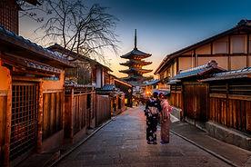 Narrow street in Japan with women in kimonos