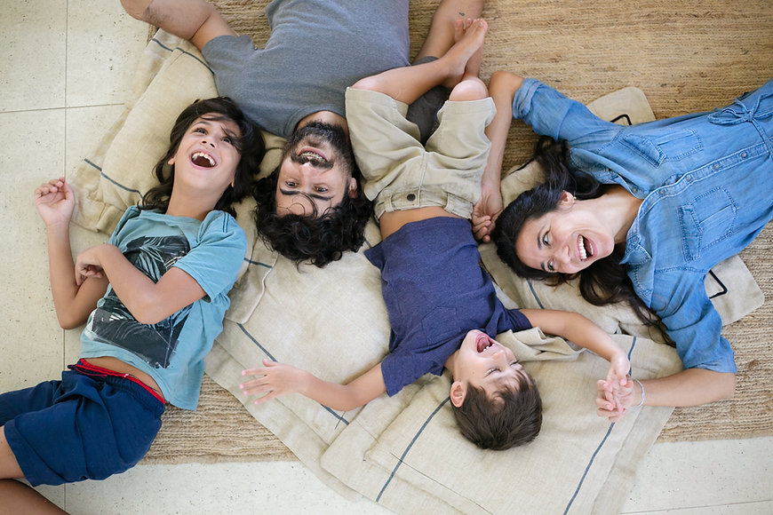 AIr One Heating and Cooling in Ormond Beach Happy Family Relaxing on the floor of their living room