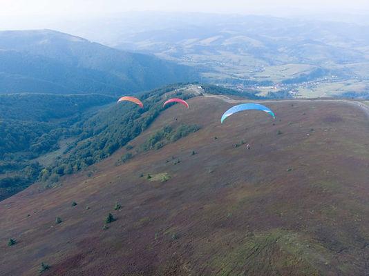 Three Paragliders