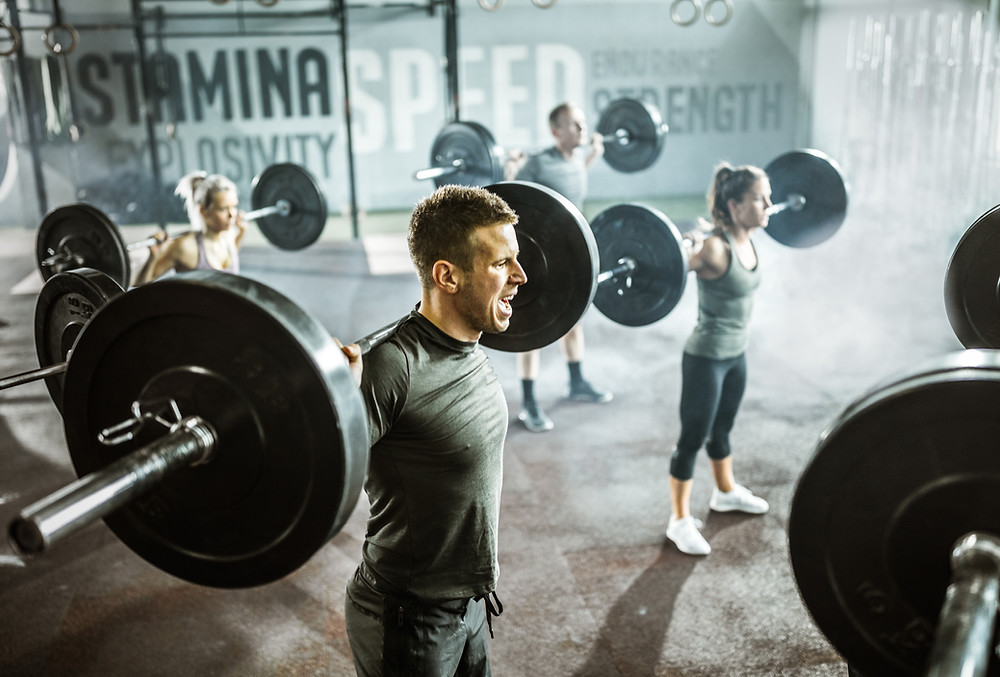 Men and Women lifting barbell, weight lifting