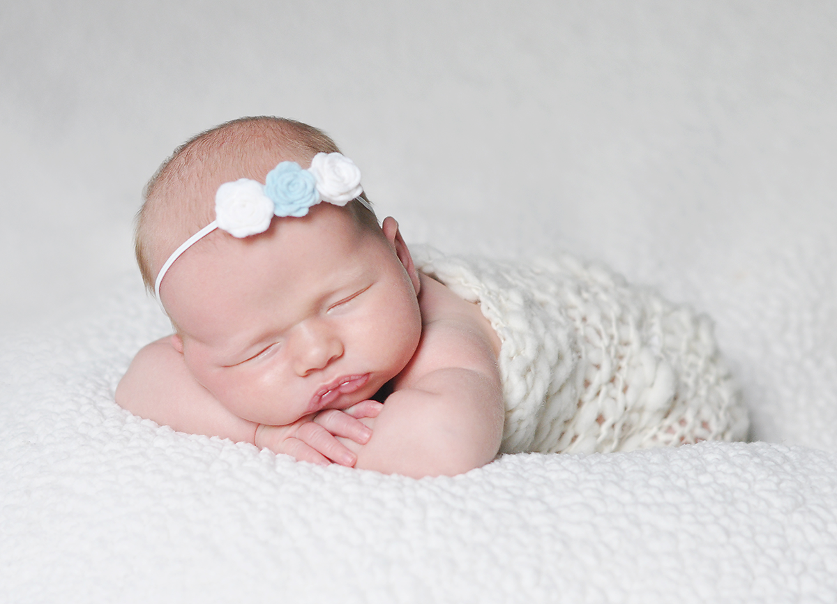 newborn girl photo in blue