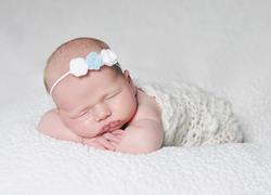 newborn girl photo in blue