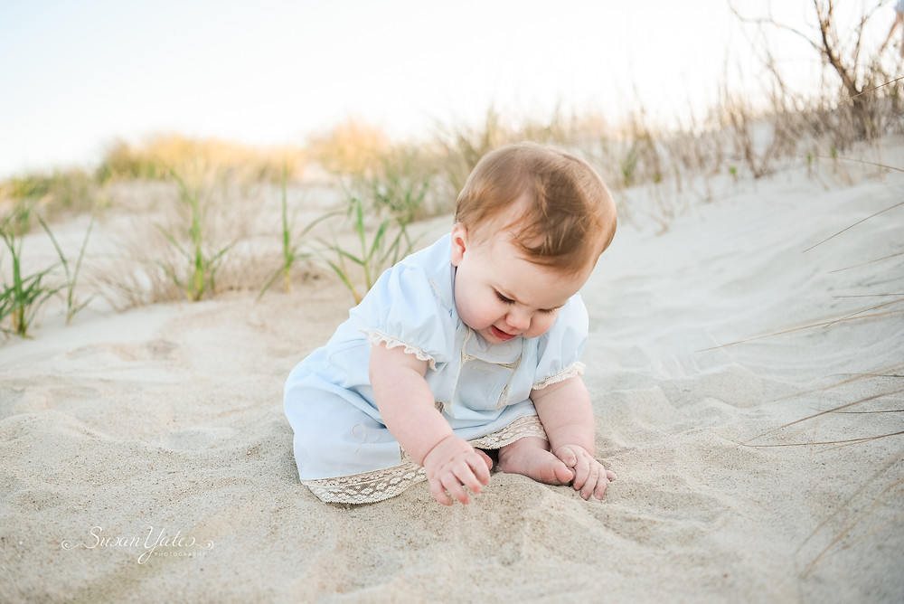 baby playing at the beach